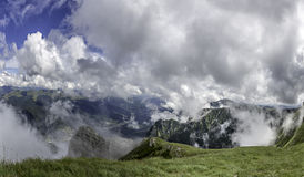 A panorama from Bucegi Mountains, Romania with a view of the tourist cities in the valley, like Sinaia and Bucegi. A beautiful day with clouds but clear view Royalty Free Stock Photos