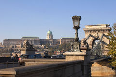 Panorama of Buda Castle and Chain River. View of Buda Castle from across the Danube River, including the Chain Bridge with lion statues and street lamp Stock Photos