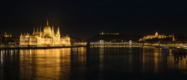 Panorama of Buda Castle, Parliament and the Danube river, Budapest, Hungary. Panorama night shot of the Danube river, the Buda Castle and the Parliament in royalty free stock image