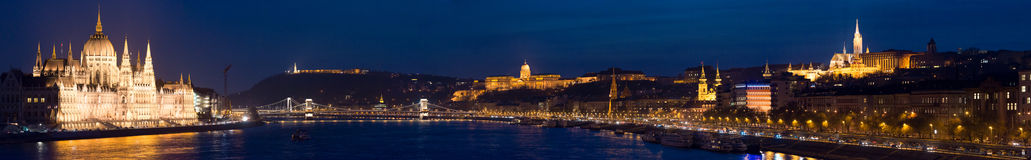 Panorama of Budapest city. Hungary, Europe. Night panorama of Budapest city. Parliament building on left, Buda castle hill on right and chain bridge in middle Stock Photo