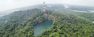 Panorama of Bukit Timah Nature Reserve. Aerial panorama of Bukit Timah nature reserve, Singapore, with the iconic Hindhede Quarry in the middle. Image captured stock photo