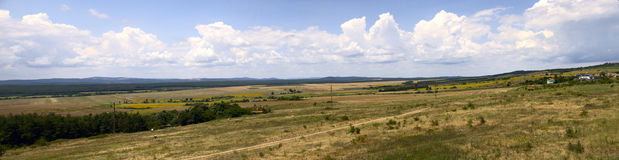 Panorama of Bulgarian fields. Panorama of mountains and blue sky with clouds Stock Image