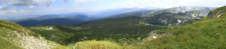 Panorama of Bulgarian mountains. Panorama of mountains and blue sky with clouds Stock Images