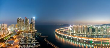 Panorama of Busan city skyline view at Haeundae district, Gwangalli Beach with yacht pier at Busan, South Korea. stock photo