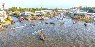 Panorama bustling boat  reverse sweep on floating market Royalty Free Stock Image