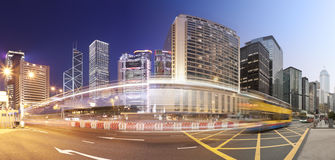 Panorama of a busy road in Hong Kong from day to Royalty Free Stock Images