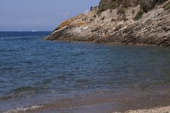 Panorama by Buzzancone beach. On the island of Elba, Italy. Beautiful seascape of Buzzancone beach. This place is located on the Elba Island, in Italy, Tuscany royalty free stock photos