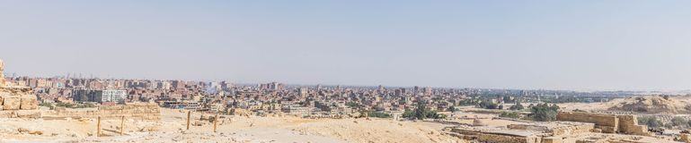 Panorama of Cairo from the Great Pyramids. Egypt. The Great Sphinx`s of Giza head is seen from behind royalty free stock images