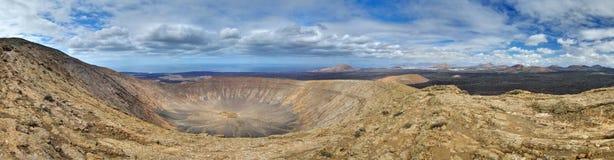 Panorama of Caldera Blanca, Lanzarote, Canary. Panorama of the Caldera Blanca volcano. Canary Islands, Lanzarote, Timanfaya National Park. Atlantic Ocean in Royalty Free Stock Image