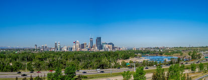 Panorama of Calgary and Rocky Mountains Stock Images