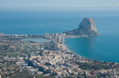 Panorama of Calpe Calpe town, Spain. Overlooking the coast, th. E harbor, lake and Ifach cliff. Shot from top of mountain near town Royalty Free Stock Photos