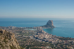 Panorama of Calpe Calpe town, Spain. Overlooking the coast, th. E harbor, lake and Ifach cliff. Shot from top of mountain near town Stock Photography