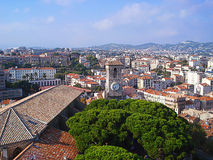 Panorama of Cannes and clock Stock Images