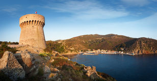 Panorama of Capraia harbour, rocks and yacht in bay on Capraia Royalty Free Stock Photo