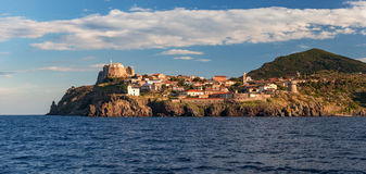 Panorama of Capraia harbour and town from the sea, rocks, yacht Stock Photo