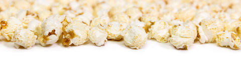 Panorama, caramel popcorn on white background with copyspace Stock Images