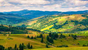 Panorama Carpathian mountain landscape with blue cloudy sky in summer Stock Image