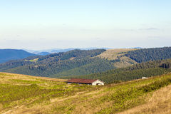 Panorama of Carpathian mountains in summer sunny day and farm on Royalty Free Stock Images