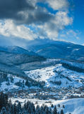 Panorama of Carpathian valley covered by snow. Panorama of Carpathian mountain valley covered by fresh snow. Sunny winter day. Ukraine, Europe Stock Image