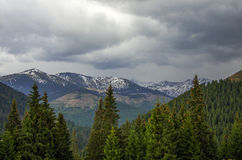 Panorama of Carpathians mountains with stormy clouds sky and sno Stock Photography