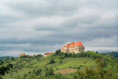 Panorama of a Castle on a hill. Castle on a hill in Veliki Tabor, Croatia. Castle with red roof on an overcast day stock image
