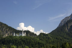 Panorama of castle Neuschwanstein in the Bavarian Alps Royalty Free Stock Image