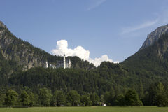 Panorama of castle Neuschwanstein in the Bavarian Alps Royalty Free Stock Images