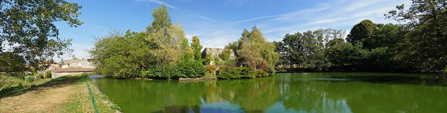 Panorama of the castle pond of Mortemart Royalty Free Stock Photography