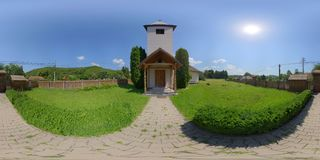 360 panorama of the Catholic chapel exterior in Vármező Câmpu Cetății / Burgfeld, Transylvania, Romania. 360 spherical panorama of the churchyard Stock Photos