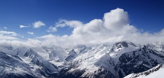 Panorama of Caucasus Mountains in sunny clouds Stock Images