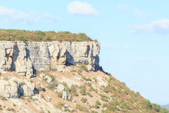 Panorama of the caves and walls. Chufut Kale. Bakhchysaray. Crimea. Stock Images