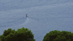 Panorama of Cavtat waters with boat passing by stock video