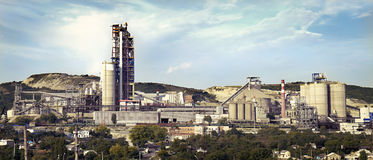 Panorama of a cement plant in a sunny summer afternoon Royalty Free Stock Photo