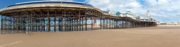 Panorama of central pier. A panorama of cetral pier blackpool from the sea end Stock Photo