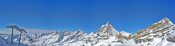 Panorama from Cervinia (3800m). A panorama composition of 3 shots at about 3800m over western alps in italy (Cervinia Royalty Free Stock Photography