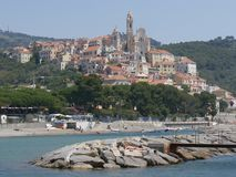 Panorama of Cervo. Panorama from the beach of the medieval village of Cervo, Liguria, Italy Royalty Free Stock Image