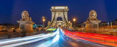 Panorama of Chain bridge at night with car light trails in Budapest Hungary. Panorama of Chain bridge at night with car light trails in Budapest, Hungary royalty free stock images
