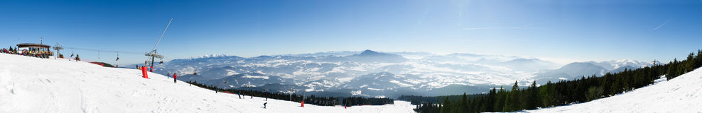 Panorama of chair lift on the top of ski slope of skiing park Kubinska Hola in winter. Stock Photo