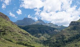 Champagne Valley near Winterton, forming part of the central Drakensberg mountain range, Kwazulu Natal, South Africa. Panorama of Champagne Valley near royalty free stock images