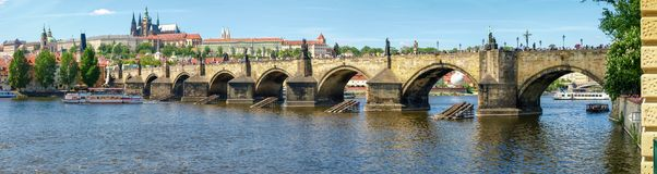 Panorama of Charles Bridge against of the Lesser Town, Prague. Panorama of the Charles Bridge over the river Vltava on background of the Lesser Town and Prague Stock Images
