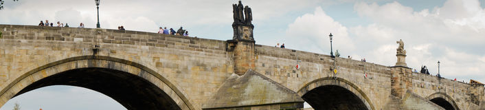 Panorama of the Charles Bridge in Prague, with statues on the side. Royalty Free Stock Photography