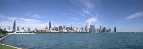 Panorama of Chicago skyscrapers, the view of downtown of Chicago from the lake. Low part of the image is lake Michigan, the upper part of the image is blue sky Royalty Free Stock Photos