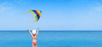 Panorama child play flying kite Royalty Free Stock Photography