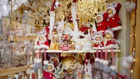 Panorama of Christmas Ornaments and Baubles: bells, snowmen, angels, stars etc. Vertical Panorama of Beautiful Showcase with Christmas Ornaments and Baubles stock video