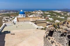 Panorama with church In the castle of Pyrgos Kallistis, Santorini island, Thira, Greece Royalty Free Stock Photo