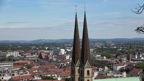 Panorama cities of Bielefeld, Germany. Red tiled roofs.Summer day. The Spire of the Church stock footage