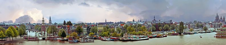 Panorama from the city Amsterdam Netherlands at sunset. Panorama from the city Amsterdam in the Netherlands at sunset Royalty Free Stock Photos