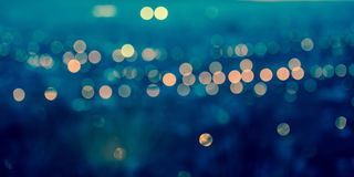Panorama city blurring lights abstract circular bokeh on toned b Royalty Free Stock Images