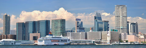 Panorama of city buildings in Hongkong harbor Royalty Free Stock Photography