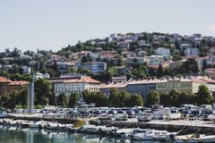 Panorama of the city with cars and boats, tilt-shift effect royalty free stock image